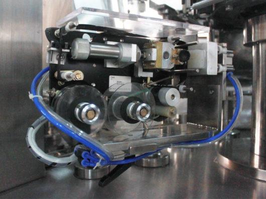 Coding machine of packaging machine